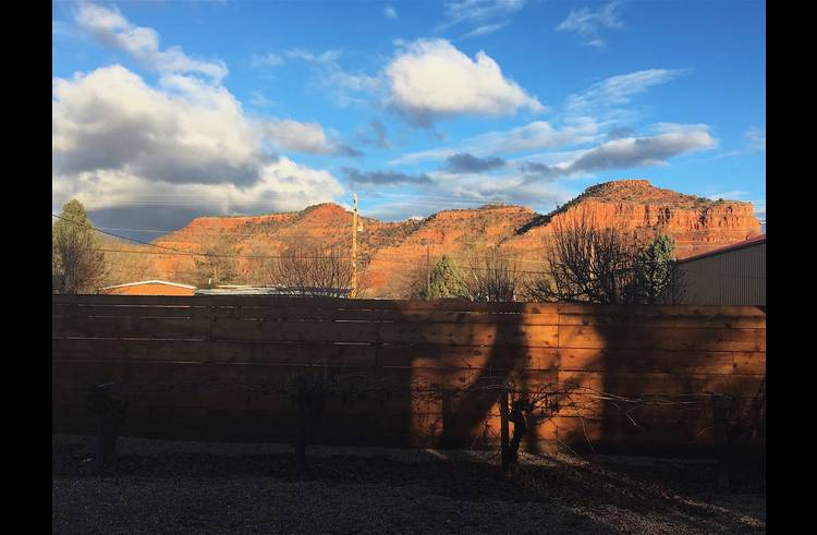 Sunset time!  Stunning backyard view of red cliffs.